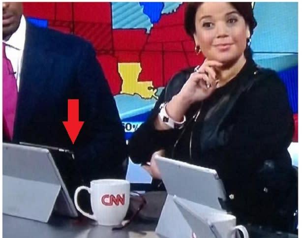 CNN anchor caught on-air using a Microsoft Surface tablet as an iPad stand