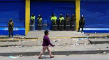Colombia boosts security after looting at stores with ties to FARC