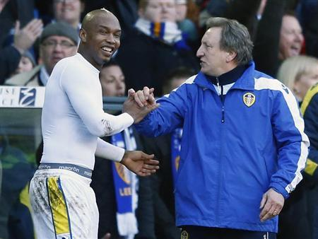 Leeds United's Diouf celebrates with manager Warnock after beating Tottenham Hotspur in their FA Cup fourth round soccer match in Leeds