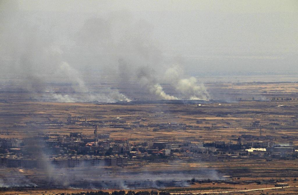 Smoke billows from the Syrian side of the armistice line on the Golan Heights on June 26, 2017 after fire into the Israeli-occupied sector sparked retaliation by the army