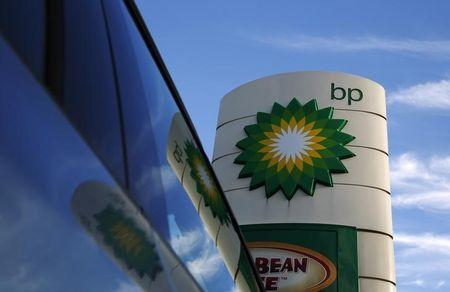 A BP logo is reflected in a car window at a petrol station in London January 15, 2015. BP is expected to announce job cuts in its North Sea operations on Thursday, the BBC reported. REUTERS/Luke MacGregor