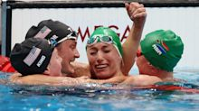 Olympic Swimmer Pulled Into Group Hug in the Water After Setting Record as 3 More Americans Win Medals
