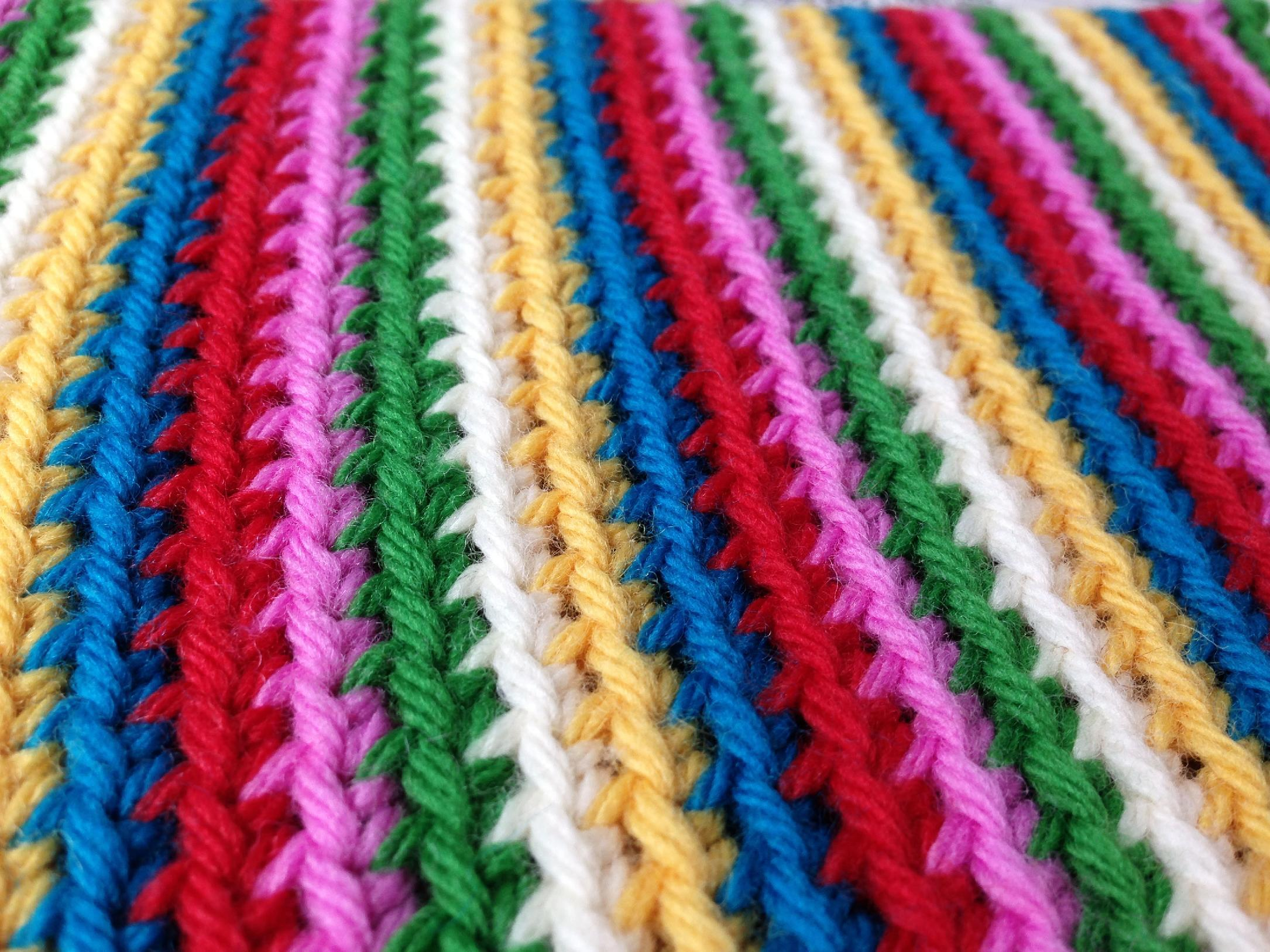 In this handout photo provided by Edie Eckman, rounds of single crochet were worked in the back loops to create colorful stripes. Today's crochet is leaner and trendier than that of the 1960s and '70s, from which we know it for its bulky, acrylic yarns and Afghan blankets. (AP Photo/Edie Eckman, Edie Eckman)