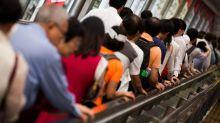 Battered From All Sides, Hong Kong Stocks Fall Into Bear Market