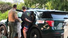Arrest made after firefighter's wallet stolen as he battled wildfires, CA officials say