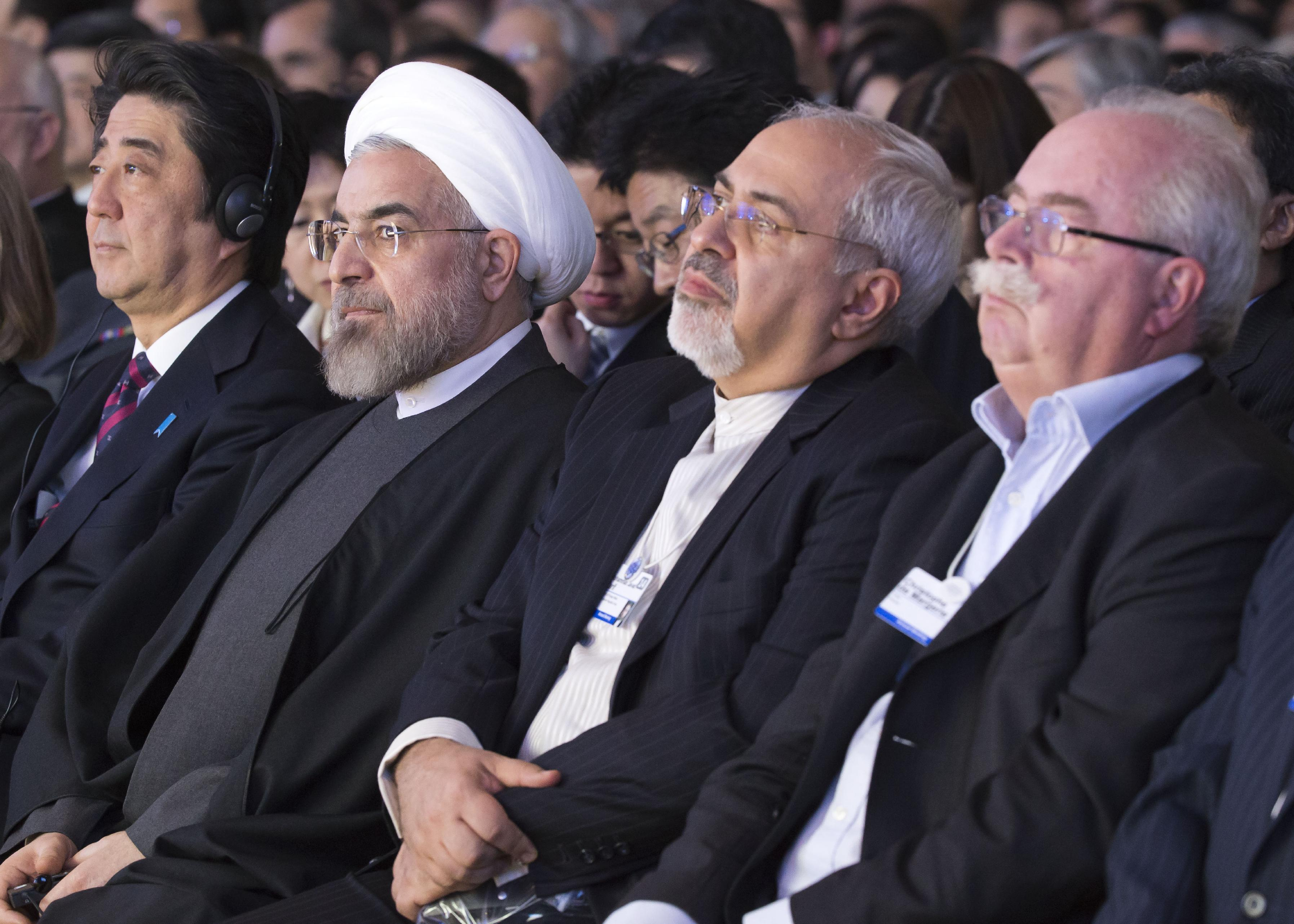 From left, Japanese prime minister Shinzo Abe, Iranian President Hassan Rouhani, Iranian Foreign Minister Mohammad Javad Zarif and CEO of Total, Christophe de Margerie, attend a session of the World Economic Forum in Davos, Switzerland, Wednesday, Jan. 22, 2014. Leaders gathered in the Swiss ski resort of Davos have made it a top priority to push to reshape the global economy and cut global warming by shifting to cleaner energy sources. (AP Photo/Michel Euler)