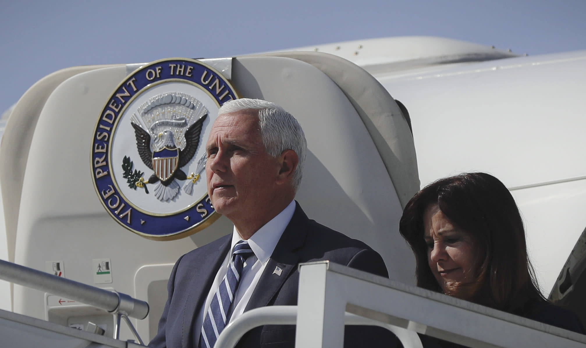 U.S. Vice President Mike Pence and his wife Karen exit the plane after landing in Warsaw, Poland, Sunday, Sept. 1, 2019. Pence will attend a memorial ceremony marking the 80th anniversary of the start of World War II. (AP Photo/Petr David Josek)