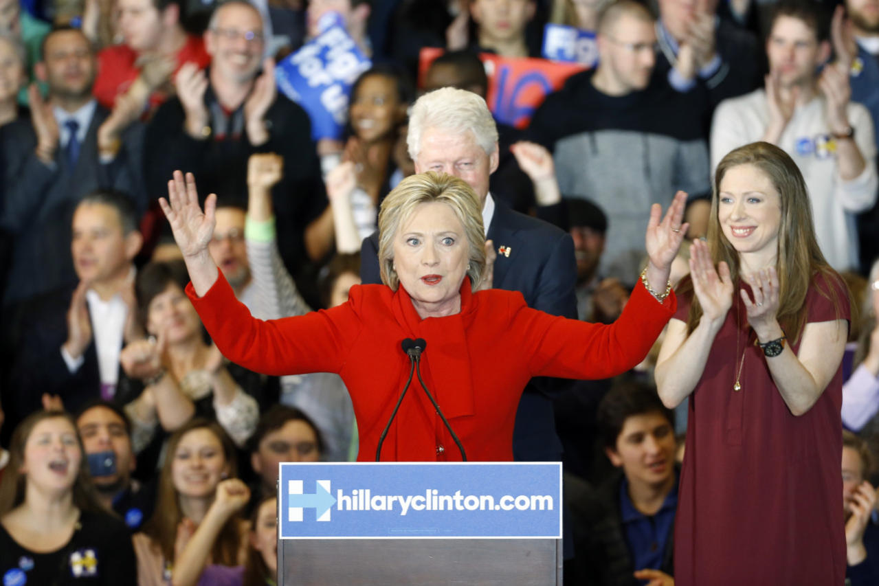 <p>Democratic presidential candidate Hillary Clinton speaks in front of former President Bill Clinton and daughter Chelsea during a caucus-night party at Drake University in Des Moines, Iowa, on Monday, Feb. 1, 2016. <i>(Photo: Patrick Semansky/AP)</i></p>
