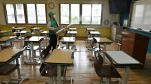 South Korean students forced online as global virus crisis deepens