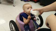 Baby Eva's homemade wheelchair steers her to success