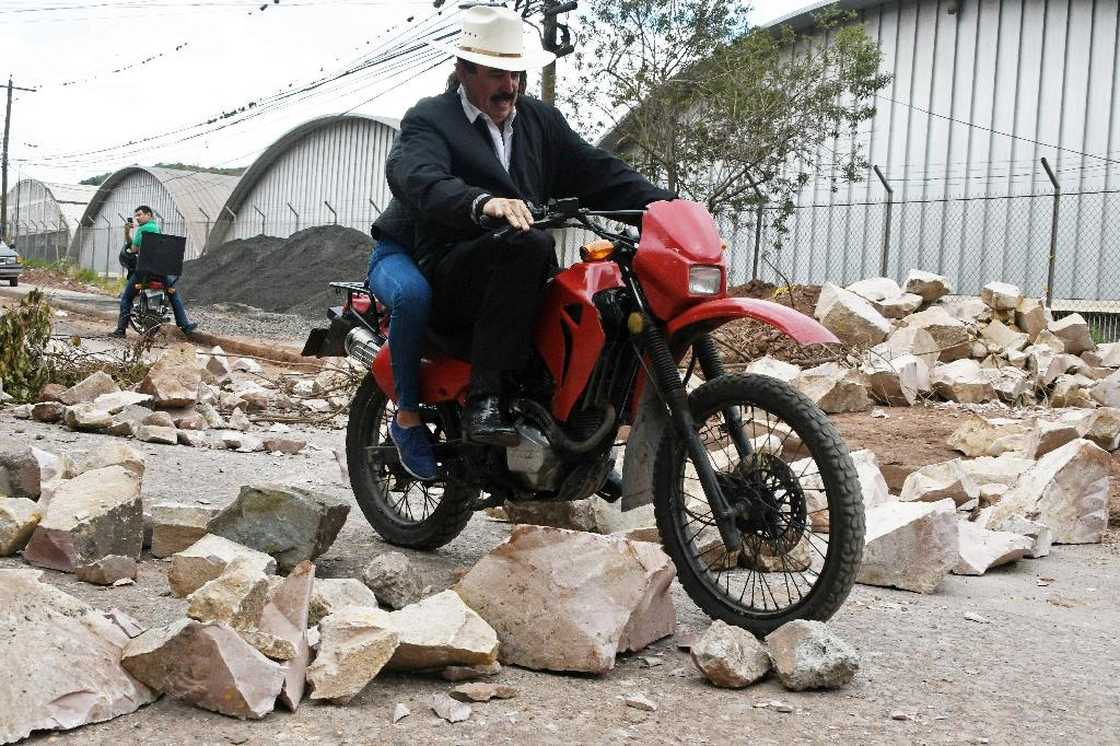 Former Honduran President Manuel Zelaya, ousted in a 2009 coup, rides a motorcycle through the blocked streets and avenues of Tegucigalpa (AFP Photo/ORLANDO SIERRA)