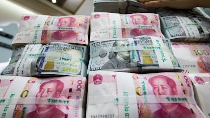 China's FX reserves drop more than expected