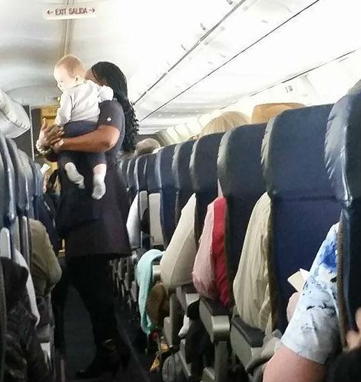 Flight Attendant Soothes Baby, Calms Stressed Mom, Saves Day