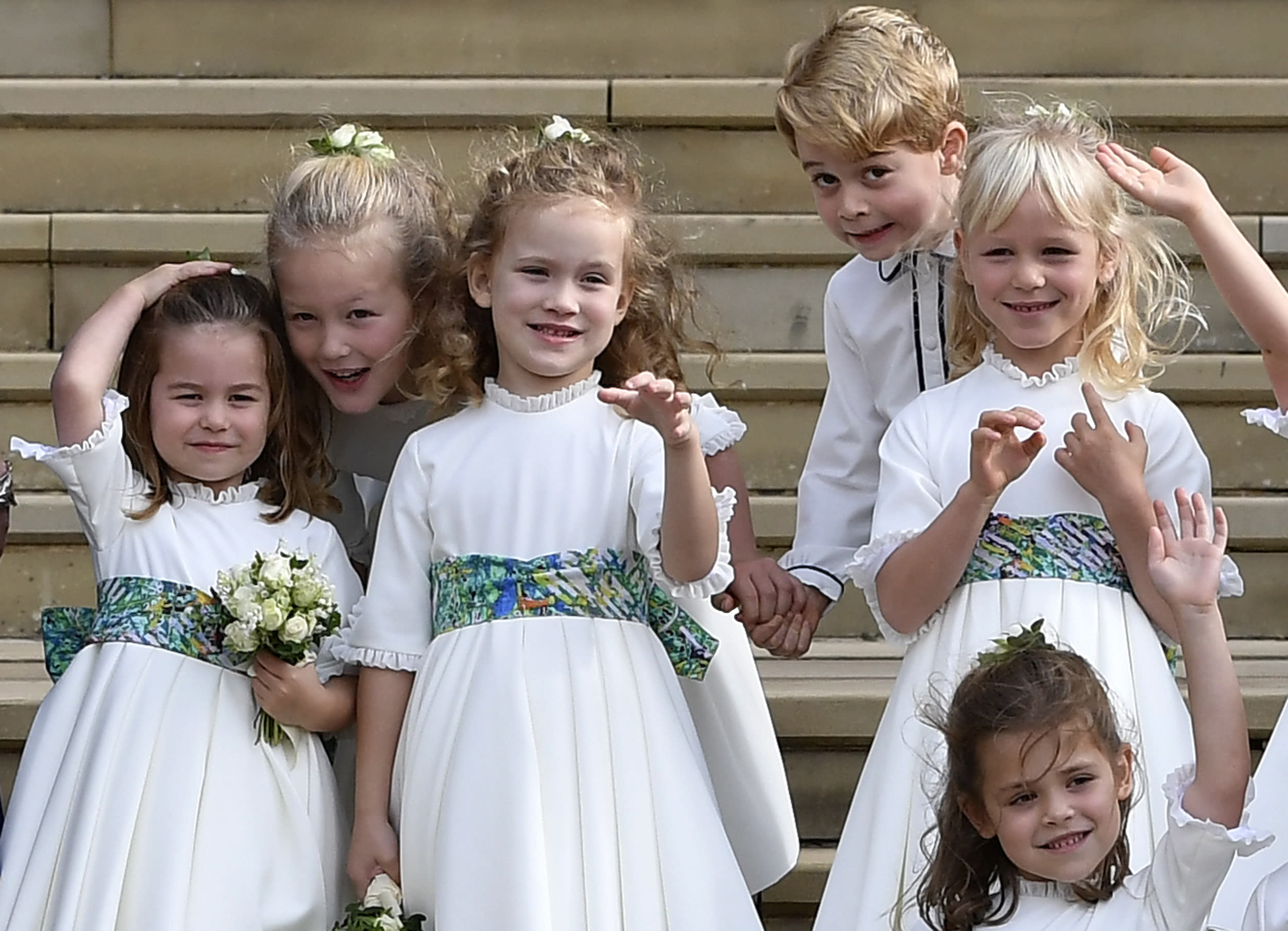 File photo dated 12/10/18 of bridesmaids and page boys, including Prince George and Princess Charlotte, waving as they leave after the royal wedding of Princess Eugenie and her husband Jack Brooksbank at St George's Chapel in Windsor Castle.