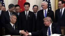 Markets climb after President Trump signs first stage of China trade deal