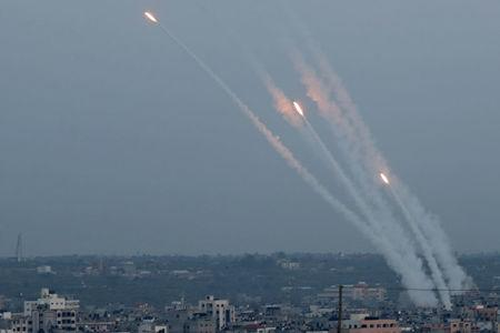 Rockets are fired from Gaza towards Israel, in Gaza