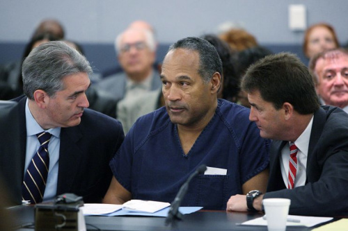 O.J. Simpson appears in court with attorneys Gabriel Grasso (L) and Yale Galanter prior to sentencing in 2008. (Getty)