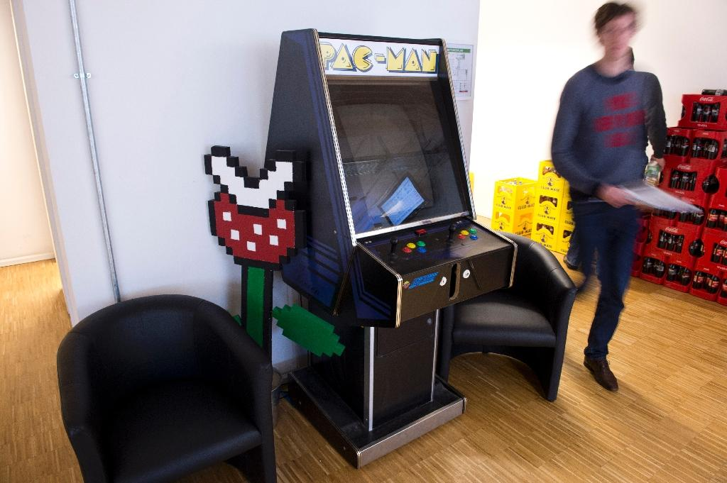 Remember these? Space Invaders -- along with Pac Man -- was originally played on huge arcade machines (AFP Photo/JOHN MACDOUGALL)