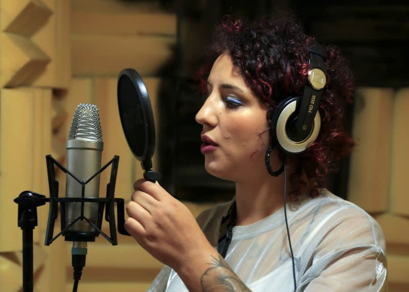 "Moroccan rapper Houda Abouz, 24, known by her stage name ""Khtek"", records a song inside a studio in Rabat"