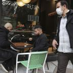 Iran's virus deaths pass 50,000 as lockdown on capital eases