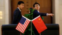 Stocks pressured as U.S.-China trade fight revives growth fears; oil elevated