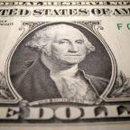 Dollar hovers near lows as kiwi climbs