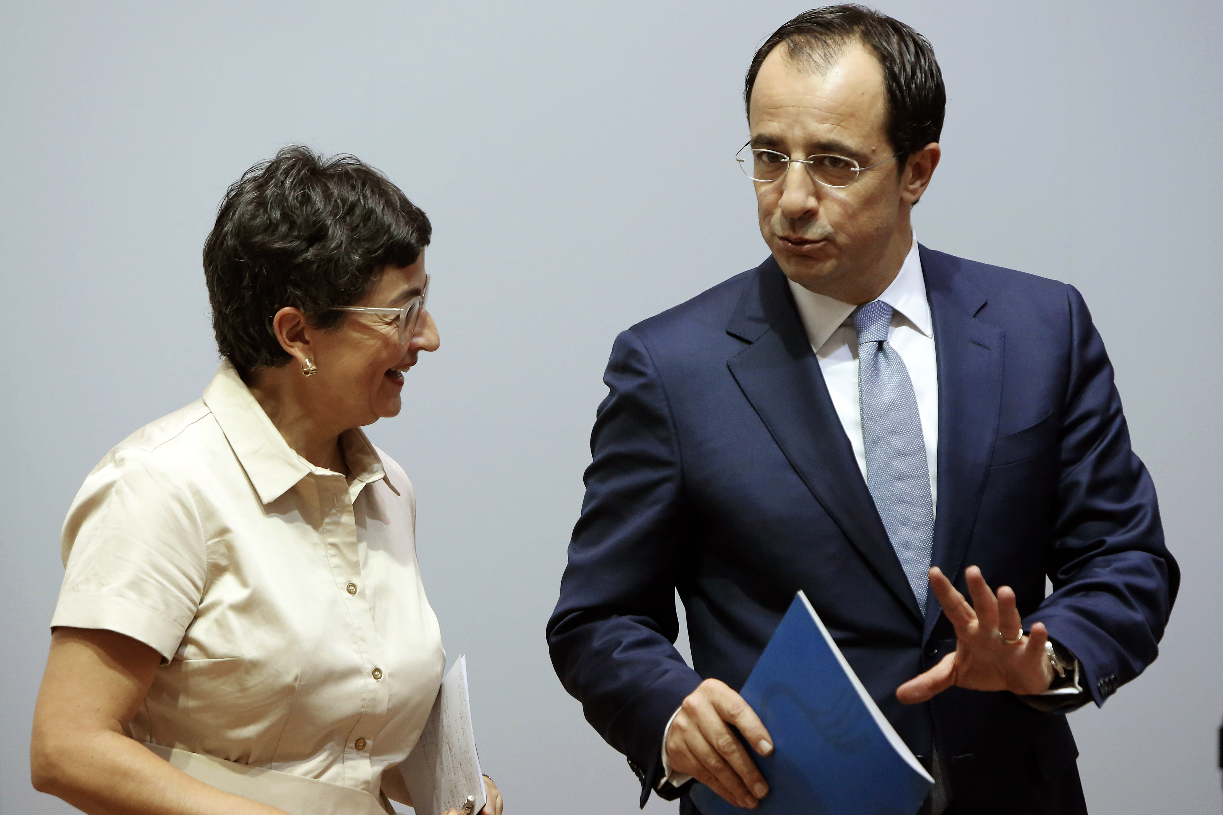 Spain's Foreign Minister Arancha Gonzalez Laya, left, with her Cypriot countepart Nikos Christodoulides talk after a news conference at the Cypriot Foreign Ministry building in the capital Nicosia, Cyprus, on Wednesday, Sept. 30, 2020. Laya said her visit aimed to convey her country's solidarity with Cyprus amid tensions over a Turkish gas search in waters were Cyprus claims exclusive economic rights. (AP Photo/Petros Karadjias)
