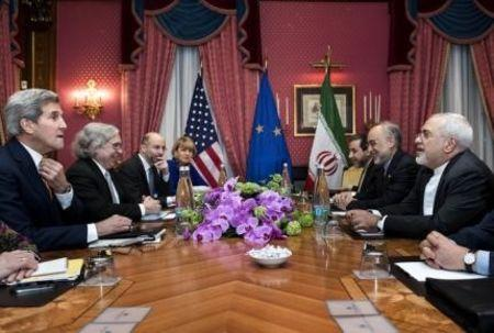 U.S. Secretary of State John Kerry (L), U.S. Secretary of Energy Ernest Moniz (2nd L), Head of the Iranian Atomic Energy Organisation Ali Akbar Salehi (2nd R) and Iranian Foreign Minister Javad Zarif (R) wait with others ahead of a meeting at the Beau Rivage Palace Hotel in Lausanne on March 26, 2015 during negotiations on the Iranian nuclear programme. REUTERS/Brendan Smialowski/Pool