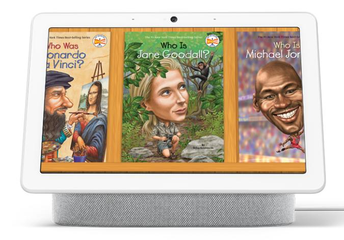 """Google Assistant Who Was Stories. A Google Nest smart display showing three storybook covers titled """"Who Was Leonardo Da Vinci,"""" """"Who Is Jane Goodall"""" and """"Who Is Michael Jordan."""""""