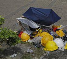 AP PHOTOS: Umbrellas, a Hong Kong protest symbol, broken