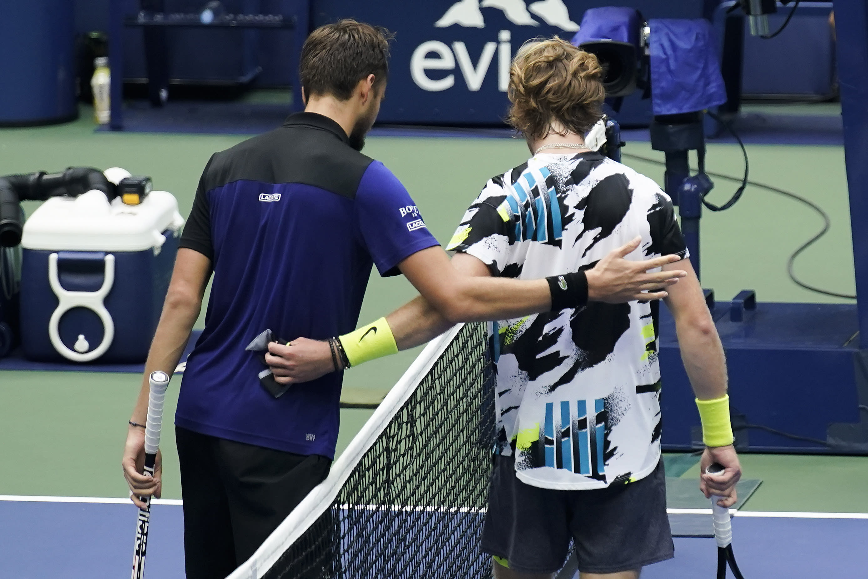 Daniil Medvedev, of Russia, left, greets Andrey Rublev, of Russia, at the net after winning their quarterfinal match of the US Open tennis championships, Wednesday, Sept. 9, 2020, in New York. (AP Photo/Seth Wenig)