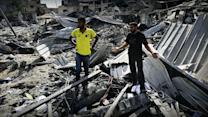 Gaza residents bury dead, survey damage during cease-fire