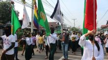 """Myanmar activists stage """"bloody"""" protests against military"""