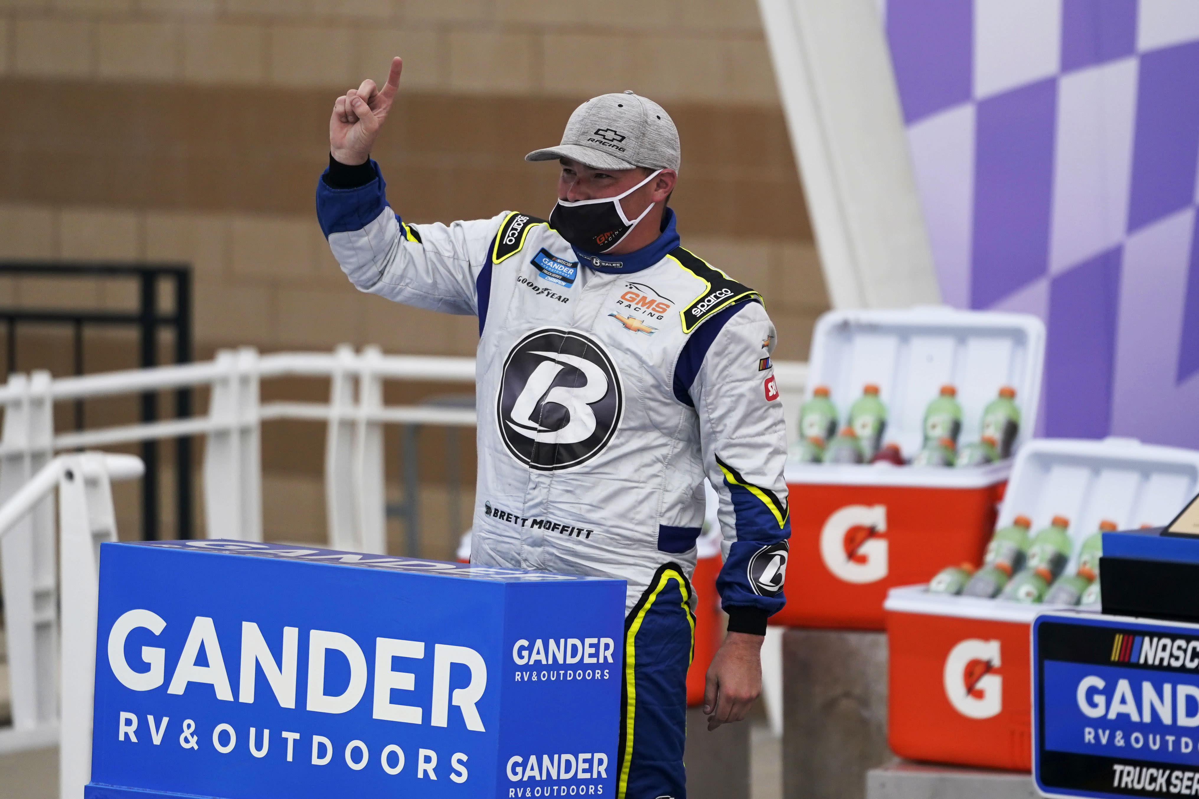 Brett Moffitt celebrates in victory lane following a NASCAR Truck Series auto race at Kansas Speedway in Kansas City, Kan., Saturday, Oct. 17, 2020. (AP Photo/Orlin Wagner)