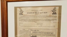 Couple touring home for sale finds KKK memorabilia, Confederate flags owned by police office