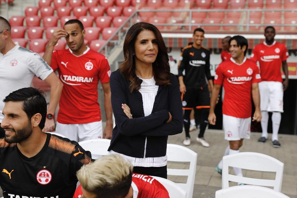 Alona Barkat, the owner of the football team Hapoel Beer Sheva, mixes with players at the club (AFP Photo/MENAHEM KAHANA)