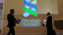Standard Chartered freezes hiring, warns of bonus cuts - memo