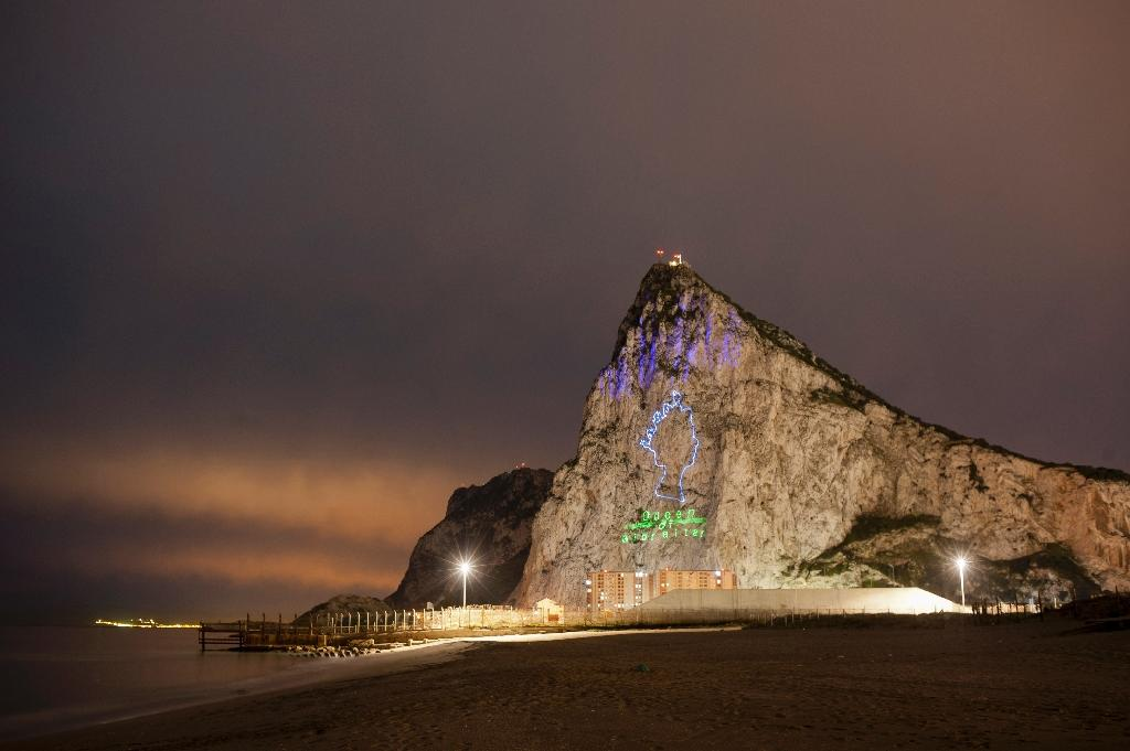 An image of Queen Elizabeth II was projected on the Rock of Gibraltar to mark her 90th birthday in April (AFP Photo/Jorge Guerrero )