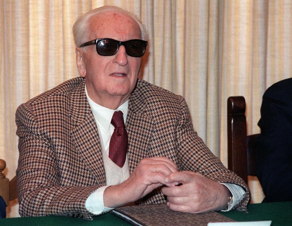 Formula One legend Enzo Ferrari, pictured in March 1987, is buried in a cemetery in Modena behind a plate of marble in a large chapel secured by a heavy iron gate