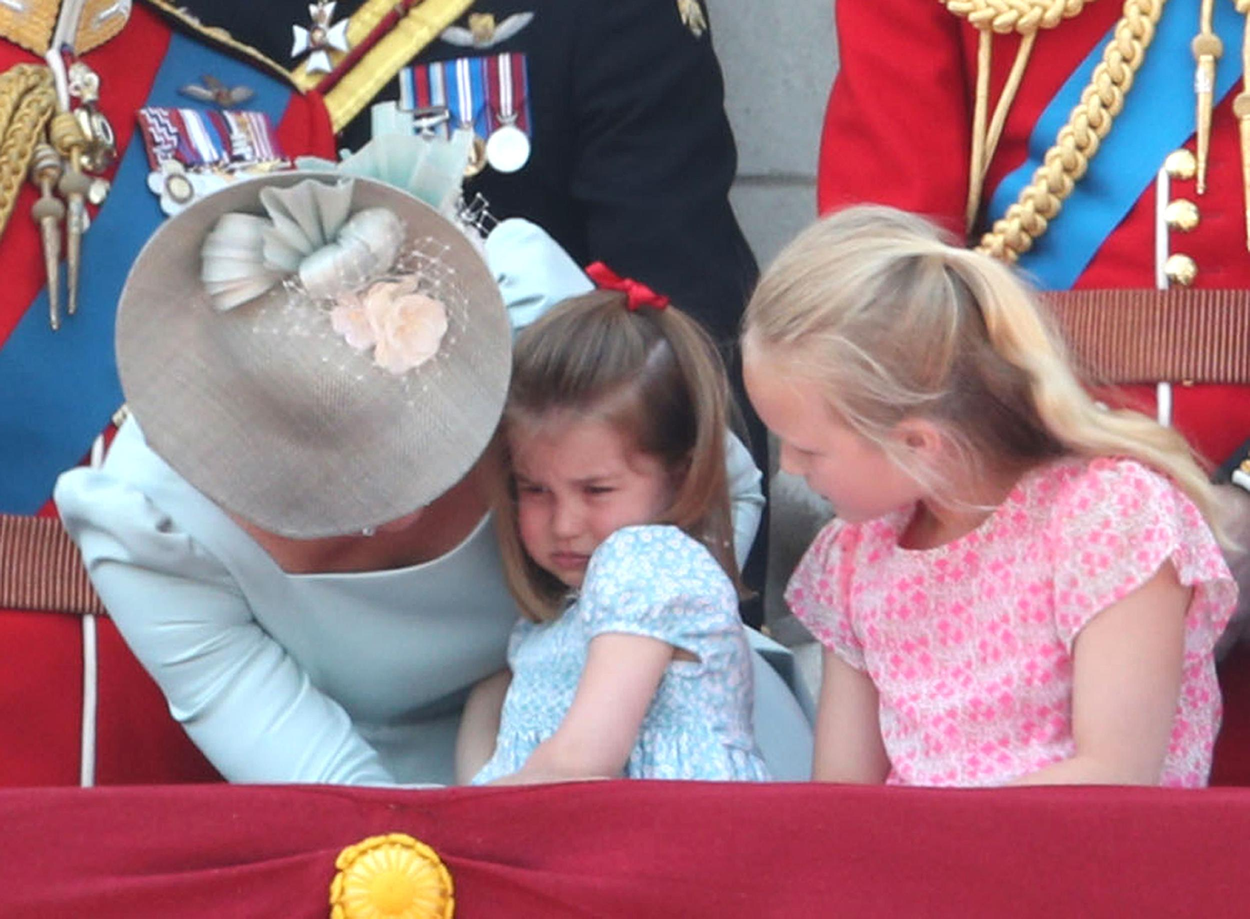 File photo dated 09/06/18 of the Duchess of Cambridge supporting Princess Charlotte on the balcony of Buckingham Palace, in central London, following the Trooping the Colour ceremony at Horse Guards Parade as the Queen celebrated her official birthday.