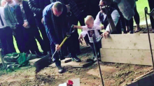 Heartbreaking photo of toddler pouring earth on father's grave shared in bid to stop knife crime