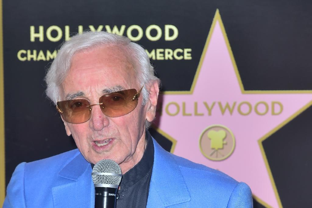 French icon Charles Aznavour, who was honored Thursday with a star on the Hollywood Walk of Fame, is one of the 20th century's most prolific entertainers (AFP Photo/FREDERIC J. BROWN)