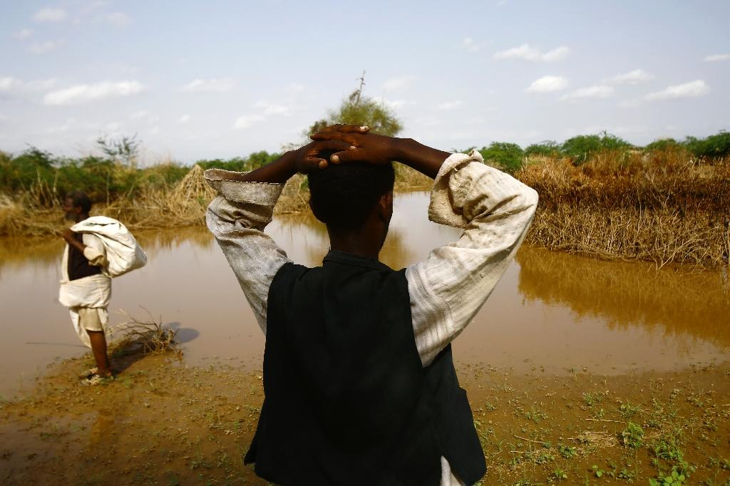A Sudanese man looks at the river Gash that burst its banks flooding the village of Makli on August 14, 2016, destroying thousands of houses and submerging several villages (AFP Photo/Ashraf Shazly)