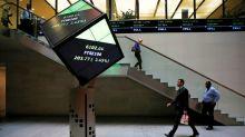 Evraz, Micro Focus lead FTSE higher in choppy trade