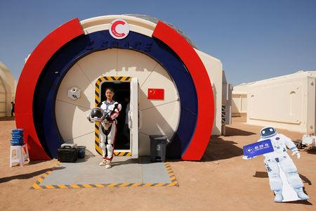 A staff member poses in a mock space suit at the C-Space Project Mars simulation base in the Gobi Desert outside Jinchang, Gansu Province, China, April 17, 2019. REUTERS/Thomas Peter