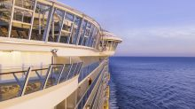 Woman banned for life from Royal Caribbean cruises after climbing on ship's railing to take a photo