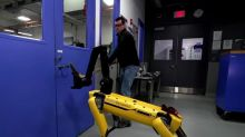 Boston Dynamics robot fights back against armed man to open door and enter room