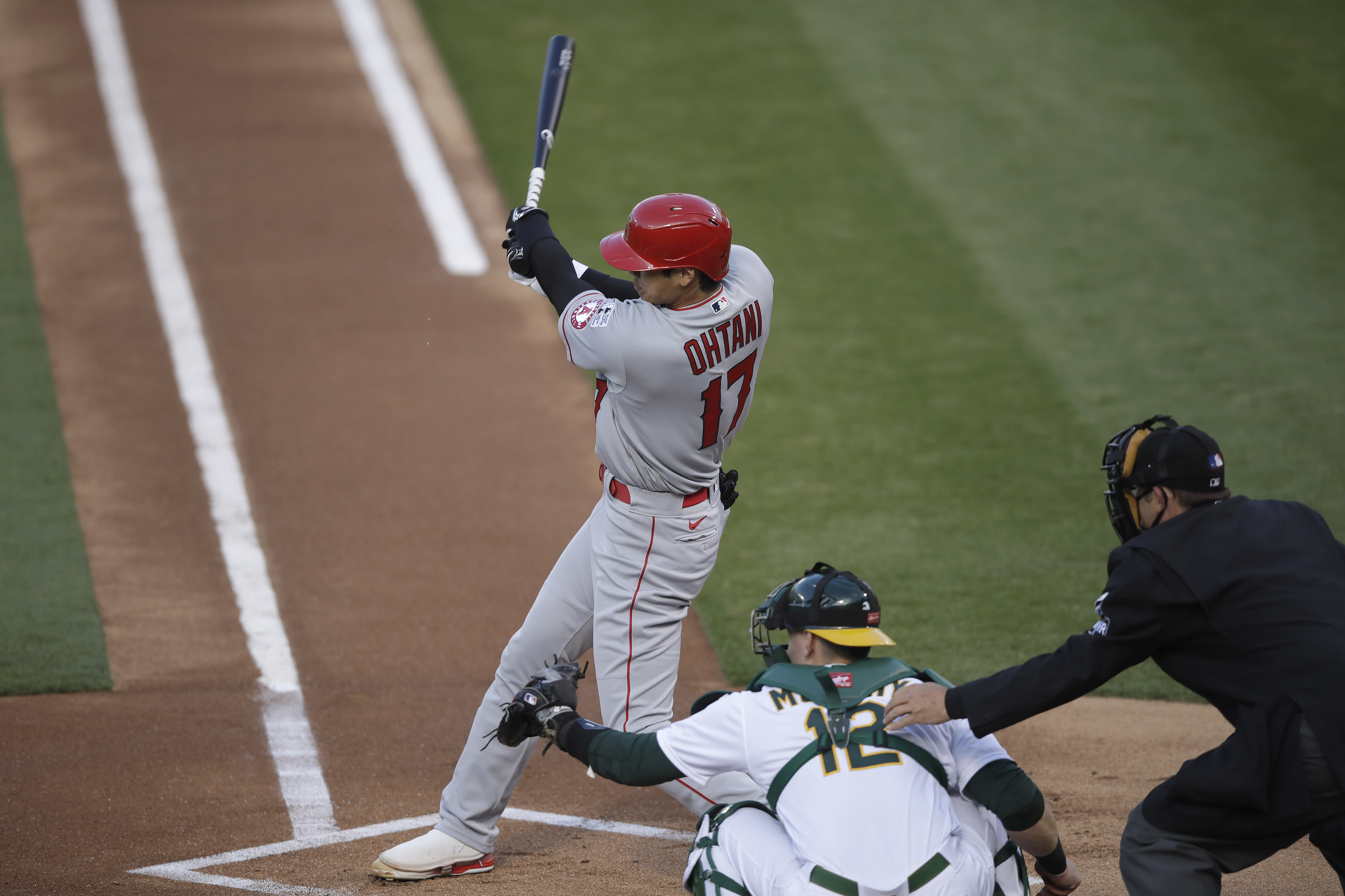 Los Angeles Angels' Shohei Ohtani singles against the Oakland Athletics during the first inning of a baseball game in Oakland, Calif., Friday, July 24, 2020. (AP Photo/Jeff Chiu)