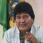 Morales denounces 'illegal' warrant for arrest as supporters 'burn opponents' houses'