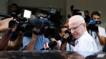 Ex-IOC executive Hickey's lawyers request return of passport